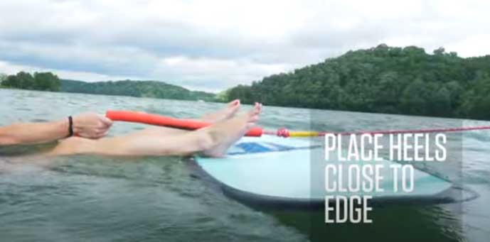 foot position for wakesurfing. Be sure to place your feet on the edge of the wakesurf board.